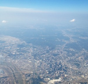 Have you never seen Dallas ... ? Flying out of D-FW we had to get on up a ways in the air to see the city (below, right.) Photo by EFD