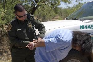A CPB agent cuffs a Mexican national. Border Patrol photo